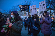 Participants hold banners with the faces of the victims of the Hanau terror attack, during a memorial demonstration, commemorating the anniversary to the Hanau terror attack, in Berlin, Germany, February 19, 2021. About 800 participants took part in the event in remembrance of the Hanau shootings, in which ten people were killed and five others wounded. The shooting spree was committed on February 19, 2020 by a far-right extremist targeting two shisha bars and kiosks at the Hessian city of Hanau near Frankfurt. The gunman was identified as 43-year-old Tobias Rathjen. The majority of the victims were Germans with migrant backgrounds, among the victims was also the perpetrator's mother. (Photo by Omer Messinger)