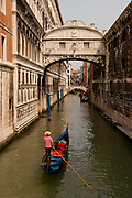 Bridge of Sighs connecting the Doge's Palace with the prison with a gondola on the Rio di Palazzo. Venice, Italy