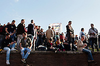 ROME, ITALY - 21 APRIL 2013: Supporters of the Five-Star Movement march gather on a hill by the Colosseum to listen to Five Stars Movement representatives during a rally the day after the re-election of President Giorgio Napolitano,  in Rome, Italy, on April 21, 2013.<br /> <br /> Italy's lawmakers re-elected 87-year-old President Giorgio Napolitano on Saturday in a bid to break the country's political gridlock, as protestors outside parliament protested agains the result. Giorgio Napolitano won with a  majority of 738 ballots out of 1,007 possible votes, ahead of leftist academic Stefano Rodota, backed by the the anti-establishment Five Star Movement, who scored 217.