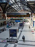 Gre0094991 . Daily Telegraph <br /> <br /> DT News<br /> <br /> A quiet Liverpool street station . Numbers are down from 800 passengers a train to 60 during rush hour according to a member of staff . <br /> <br /> Empty streets in London's financial district after the Easter weekend  . Britain is still in lockdown due to the Covid-19 pandemic which has cost over 1000 loves .<br /> <br /> London 14 April 2020