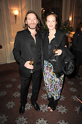 POLLY MORGAN and MAT COLLISHAW at a dinner hosted by Vogue in honour of photographer David Bailey at Claridge's, Brook Street, London on 11th May 2010.