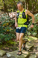 Kerhonkson, New York  - A runner in the 70-mile race follows the trail at Minnewaska State park during the Shawangunk Ridge Trail Run/Hike on Sept. 16, 2017.