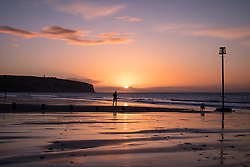 © Licensed to London News Pictures. 07/04/2016. Sandown, UK. A runner at sunrise at Sandown Bay on the Isle of Wight this morning, Thursday 7th April 2016. Photo credit : Rob Arnold/LNP