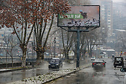 """A billboard showing a military man in the city centre of Kapan, Syunik Province in Southern Armenia,  says """"we will win"""" pictured on Friday, Dec 18, 2020. Unverified reports suggest that the Mayor of Kapan Gevorg Parsyan have said that the military positions of 13 settlements of Syunik region including Kapan, should be surrendered to Azerbaijan by Friday, 5/pm. Kapan is a provincial capital of Syunik Province in southeast Armenia. It is located in the valley of the Voghji River and is on the northern slopes of Mount Khustup. Kapan lays along the disputed borderline with Azerbaijan with whom Armenia's long-standing frozen conflict escalated into a full scare of war for the 3rd time on Sept 27, 2020. (Photo/ Vudi Xhymshiti)"""