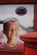 Poster boy advertising the Royal Mail's post office in south London as many branches close due to recession.