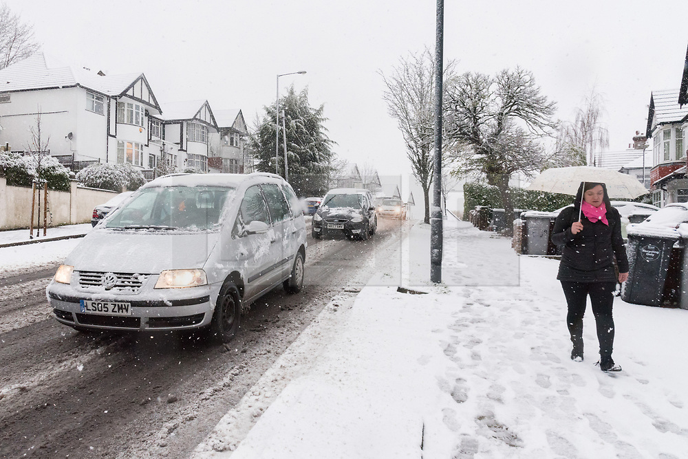 © Licensed to London News Pictures. 10/12/2017. London, UK. A woman walks early morning along the roads of Wembley, North London. Heavy snow weather hit the capital causing travel disruption. Photo credit: Ray Tang/LNP
