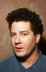 Portrait of man wearing polo shirt,