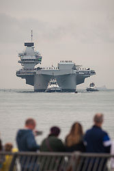 © Licensed to London News Pictures. 16/08/2017. Portsmouth, UK.  The Royal Navy's new aircraft carrier HMS Queen Elizabeth arriving in Portsmouth for the first time. Thousands of people lined the shores of Portsmouth and Southsea to welcome the Royal Navy's newest and largest ever ship into her home port. Photo credit: Rob Arnold/LNP