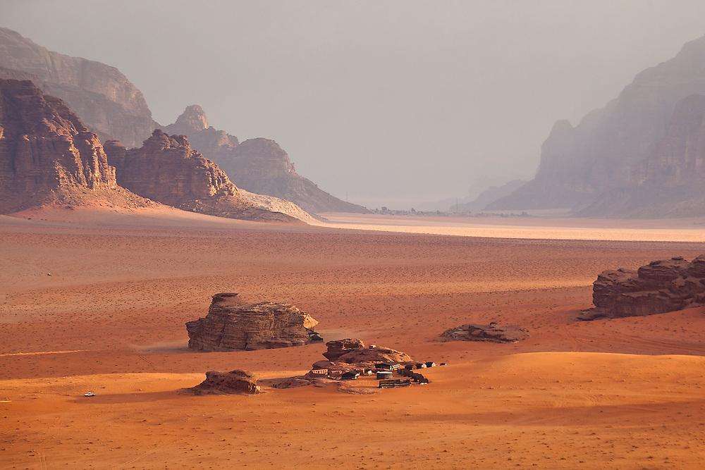 A (tourist) Bedouin camp set in a broad red desert canyon in Wadi Rum, Jordan.