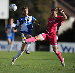 Dover Athletic's Matt Lock tackles Bristol Rovers' Matt Taylor - Photo mandatory by-line: Alex James/JMP - Mobile: 07966 386802 - 04/10/2014 - SPORT - Football - Bristol - Stoke Gifford Stadium - Bristol Academy Womens v Notts County Ladies - Womens Super League