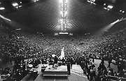 The Fab Four's fans fill up the Coliseum at the Beatles' 1964 performance in Seattle. For the police, it was crazy duty trying to deal with the 'mass hysteria'; for the kids, it was the time of their lives. (Vic Condiotty / The Seattle Times)