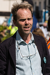 Extinction Rebellion spokesperson and green campaigner Rupert Read is interviewed during a Back The Bill rally in Parliament Square on 1st September 2020 in London, United Kingdom. Extinction Rebellion activists are attending a series of September Rebellion protests around the UK to call on politicians to back the Climate and Ecological Emergency Bill (CEE Bill) which requires, among other measures, a serious plan to deal with the UK's share of emissions and to halt critical rises in global temperatures and for ordinary people to be involved in future environmental planning by means of a Citizens' Assembly.