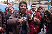 Protestor burns his passport at the Occupy Amsterdam demonstration, outside the Amsterdam Stock Exchange, Beursplein. It's not clear if the passport - which appeared to be Australian - was real, valid, or the man's own. This is one of many 'occupy' protests fallowing the Occupy Wall Street protests in New York, against economic inequality.