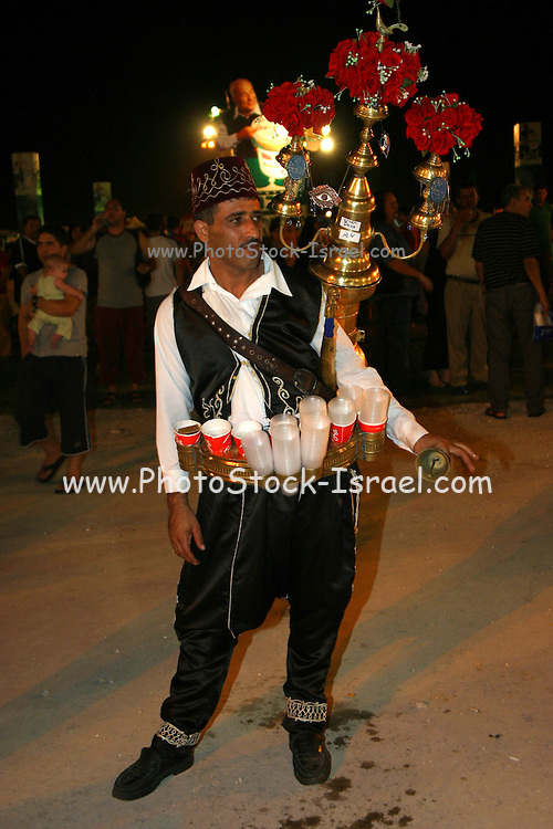 Man Selling saloop, salep; sassafras; a drink made of salep and milk. East Jerusalem, Israel