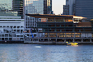 A Whistler Air floatplane taxis in the water of Coal Harbour next to Canada Place in Vancouver, British Columbia, Canada