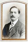 1900s portrait of adult man in golden passe-partout frame