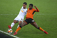 Bright Enobakhare of Wolverhampton Wanderers ® tackles Kyle Naughton of Swansea city.  The Emirates FA Cup, 3rd round replay match, Swansea city v Wolverhampton Wanderers at the Liberty Stadium in Swansea, South Wales on Wednesday 17th January 2018.<br /> pic by  Andrew Orchard, Andrew Orchard sports photography.