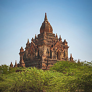 """Sulamani temple in Bagan is truely striking and is one of the more popular ones to visit with some wonderfully intricate carvings and significant murals. It was built in 1181 by Narapatisithu (1174-1211) and is known as """"crowing jewel"""" as part of many thousands of temples in the plains around Old Bagan. Having survived many of the recent earthquakes it's distinctive style and prominence means it is also a popular site to catch in sunrise and sunset photos!"""