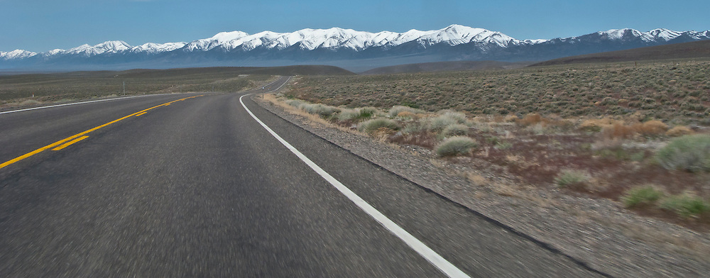 US 50 crosses the high Nevada desert toward snowcapped peaks of the Toiyabe Range on the horizon