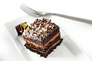 SHOT 4/30/14 11:57:07 AM - Vollmer's Bakery and Cheesecake Factory, based in Denver, Co., product line photography. Vollmer's cheesecakes, tortes, specialty cakes and pastries are available in food stores, gourmet markets, selected restaurants and caterers throughout the country. Triple Chocolate Blackout Chocolate cake with rich chocolate mousse and chocolate ganache. (Photo by Marc Piscotty / © 2014)