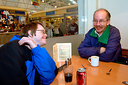 Group of men with learning disabilities in cafe; Bradford; Yorkshire UK