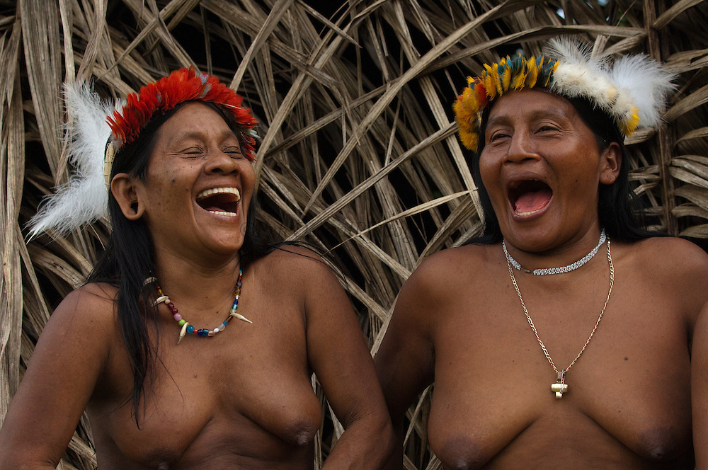 Huaorani women, Awame Gomoke & Dete Iteka both wearing crowns topped with Harpy Eagle feather<br /> Bameno Community. Yasuni National Park.<br /> Amazon rainforest, ECUADOR.  South America<br /> This Indian tribe were basically uncontacted until 1956 when missionaries from the Summer Institute of Linguistics made contact with them. However there are still some groups from the tribe that remain uncontacted.  They are known as the Tagaeri & Taromenane. Traditionally these Indians were very hostile and killed many people who tried to enter into their territory. Their territory is in the Yasuni National Park which is now also being exploited for oil.