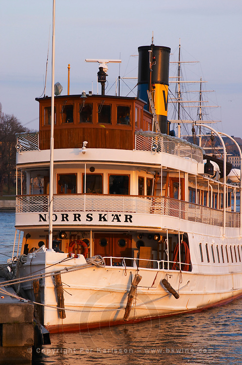 Norrskar moored at the Blasieholmen. White Waxholm boats Waxholmsbatar typical for the archipelago traffic. Stockholm. Sweden, Europe.