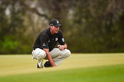 March 24, 2018 - Austin, TX, U.S. - AUSTIN, TX - MARCH 24: Matt Kuchar lines up a putt during the Round of 16 for the WGC-Dell Technologies Match Play on March 24, 2018 at Austin Country Club in Austin, TX. (Photo by Daniel Dunn/Icon Sportswire) (Credit Image: © Daniel Dunn/Icon SMI via ZUMA Press)
