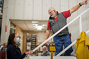 """14 OCTOBER 2020 - KNOXVILLE, IOWA: THERESA GREENFIELD, the Democratic candidate for US Senator from Iowa, (left) talks to MAX SMITH in the mechanical shop at Smith Fertilizer and Grain. Greenfield toured Smith Fertilizer and Grain in Knoxville and talked to owner Max Smith about her """"Fair Shot for Our Farmers"""" plan to improve Iowa's farm economy. Greenfield is in a tight race with incumbent Republican Senator Joni Ernst.    PHOTO BY JACK KURTZ"""