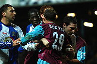 Photo: Paul Greenwood.<br />Blackburn Rovers v West Ham United. The Barclays Premiership. 17/03/2007.<br />West Ham's Lee Bowyer (R) is restrained by Blackburn's David Dunn as Chritopher Samba (C) squares upto him