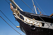 """SS Great Britain passenger steamship designed by Isambard Kingdom Brunel in 1843, in the Great Western Dockyard in which she had been built, Bristol, UK. Extensive conservation work began which culminated in the installation of a glass plate across the dry dock at the level of her water line, with two dehumidifiers, keeping the space beneath at 22% relative humidity, sufficiently dry to preserve the surviving material of the hull. This was completed, the ship was """"re-launched"""" in July 2005, and visitor access to the dry dock was restored."""