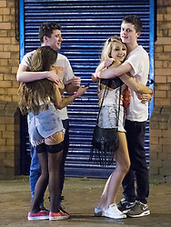 """© Licensed to London News Pictures . 22/10/2012 . Manchester , UK . Two couples hug each other tightly . Students attend a Carnage UK pub crawl at bars in Manchester 's Deansgate Locks with a fancy dress theme of """" Pimps and Hoes """" . The event has been criticised for encouraging binge drinking , sexism and anti-social behaviour . Photo credit : Joel Goodman/LNP"""
