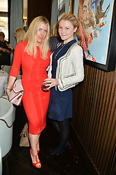 Left to right, FIONA LEAHY and AMBER ATHERTON at the 'Ladies of Influence Lunch' held at Marcus, The Berkeley Hotel, London on 12th May 2014.
