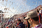 Fans of football team San Lorenzo celebrate as their players take to the pitch for a match against Racing. Football clubs San Lorenzo de Almagro and Racing Club de Avellaneda are both from Buenos Aires, Argentina, and compete in Argentina's First Division football league, Primera Divisio?n Argentina.