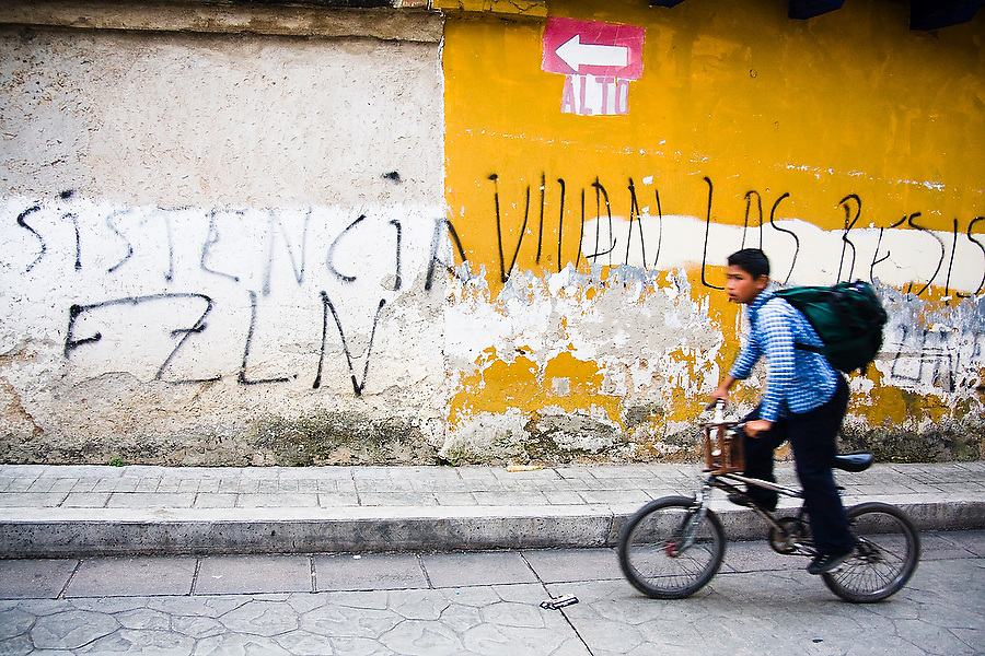 A boy bikes past EZLN graffiti in a street of San Cristobal de las Casas, Chiapas, Mexico on June 27, 2008. The Ejercito Zapatista de Liberacion Nacional (EZLN), or Zapatista National Liberation Army, is an armed revolutionary group based in Chiapas, one of the poorest regions of Mexico, a state with a large indigenous social base.