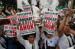 October 14, 2016 - Jakarta, DKI Jakarta, Indonesia - Hardline Muslim groups protest against Jakarta's incumbent governor Basuki Tjahaja Purnama, an ethnic Chinese Christian running in the upcoming election, in Jakarta, Indonesia, October 14, 2016.  The protest demanding the police investigation governor Basuki Tjahaja Purnama (Ahok) that is considered an insult to the religion. (Credit Image: © Dasril Roszandi/NurPhoto via ZUMA Press)