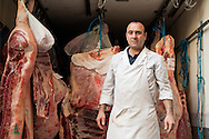 Man delivering meat to a butcher in Naples, Italy © Rudolf Abraham