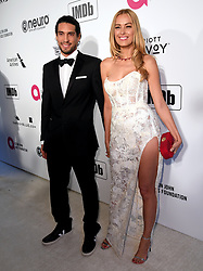 Petra Nemcova and guest attending the Elton John AIDS Foundation Viewing Party held at West Hollywood Park, Los Angeles, California, USA.