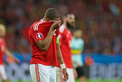 LILLE, FRANCE - Friday, July 1, 2016: Wales' captain Ashley Williams wipes his face with his shirt during the UEFA Euro 2016 Championship Quarter-Final match against Belgium at the Stade Pierre Mauroy. (Pic by Paul Greenwood/Propaganda)