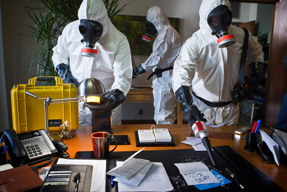In this episode of Breakout Kings, the hazmat team, clad in their protective suits, sets about decontaminating the prison. Photo: Skip Bolen / A&E Television Networks