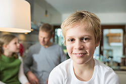 Boy with father and sister in the kitchen