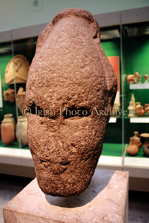 Head of Ammonite king Iron Age II, 8th century BC from Amman. This basalt head wearing Egyptian style headdress was found in the bed of the river Zarqa near Amman. It is a one of a number of similar pieces all recovered from the region Amman and which together seem to represent a local school of free standing sculpture. The piece is thought to depict a king or possibly a god.