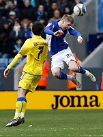 Photo: Steve Bond/Richard Lane Photography. Leicester City v Cardiff City. Coca Cola Championship. 13/03/2010. Paul Gallagher (R) clears in front of Peter Whittingham