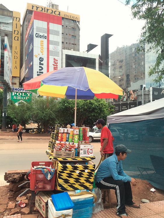 Ciudad del Este, Paraguay, South America - Street vendors in the road at the border with Brazil in Ciudad del Este.