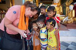 Kristina Timmerman Showing Burmese Children Their Photo<br /> At Shwedagon Pagoda