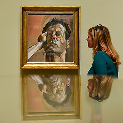 """© Licensed to London News Pictures. 23/10/2019. LONDON, UK. A staff member views """"Man's Head (Self-Portrait)"""", 1963, by Lucien Freud. Preview of """"Lucian Freud: The Self-portraits"""" at the Royal Academy of Arts in Piccadilly.  56 works on display chart Freud's artistic development over almost seven decades on canvas and paper in a show which runs 27 October to 26 January 2020.  Photo credit: Stephen Chung/LNP"""
