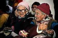 India, Ladakh. Elderly women attending the festival taking place in Phyang monastery.