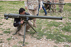 © Licensed to London News Pictures. 30/03/2015. Erbil, Iraq. Kurdish peshmerga fighters learn how to use the sights on the Breda Folgore 80mm anti-tank recoilless rifle by Italian soldiers during a training package held at a military training area near Erbil, Iraq.<br /> <br /> Italy has donated 50 of the anti-tank weapons and 1000 rockets to the peshmerga.<br /> <br /> The training is part of a four week long package, the first to be held with a complete peshmerga battalion, run by coalition forces mobile training teams (MTT) in Kurdistan with the aim to make the peshmerga more efficient in combatting the Islamic State. Photo credit: Matt Cetti-Roberts/LNP