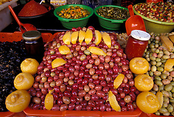 Morocco, Chefchaouen (aka Chaouen)<br /> Red, green and black olives with lemons are sold at markets throughout Morocco<br /> Used by Heineman Library - World Tour Series: Morocco <br /> Memo # 1951617 12/19/02