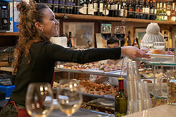 A woman serving chicheti (small snacks) in a bar in Venice. From a series of travel photos in Italy. Photo date: Sunday, February 10, 2019. Photo credit should read: Richard Gray/EMPICS